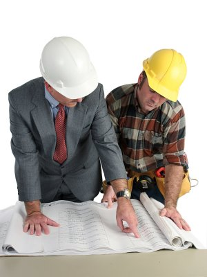 Two builders looking at house plans
